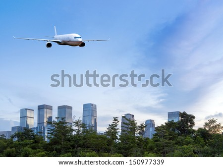 Shenzhen's skyscrapers and airplanes on sky