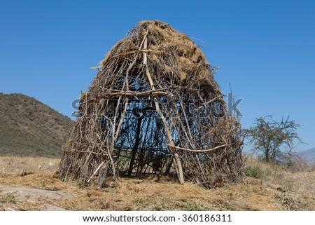 Shepherd shelter in the African savanna - stock photo