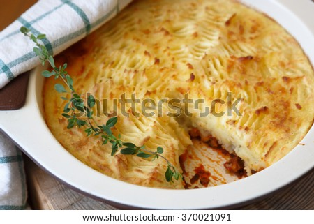 shepherds pie with missing piece, close view - stock photo