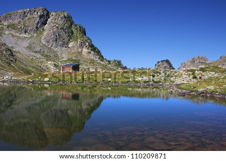 Shepperd hut on a mountain lake shore
