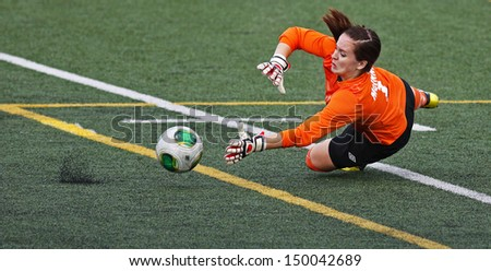 SHERBROOKE, CANADA - August 7: Women's soccer keeper Nicole McInnis of Prince Edward Island makes a save at the Canada Games August 7, 2013 in Sherbrooke, Canada. - stock photo