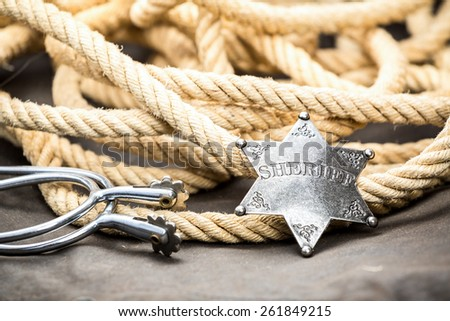 Sheriff badge, spurs and lasso. Western symbol. - stock photo