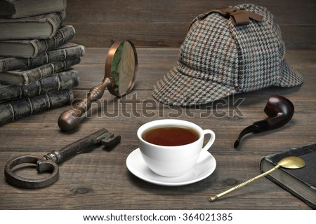 Sherlock Concept. Private Detective Tools On The Wood Table Background. Deerstalker Cap,  Magnifier, Key, Cup, Notebook, Smoking Pipe.Overhead View - stock photo