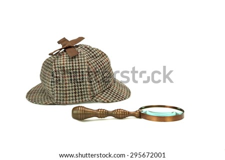 Sherlock Holmes Deerstalker Cap And Vintage Magnifying Glass Isolated On White Background. Investigation Concept - stock photo