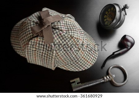 Sherlock Holmes Deerstalker Hat, Smoking Pipe, Old Key, And Retro Clock On The Black Wooden Table Background. Overhead View.  Investigation Concept.