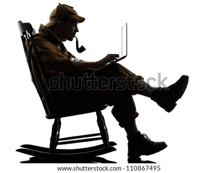 sherlock holmes with computer laptop silhouette sitting in rocking chair in studio on white background - stock photo