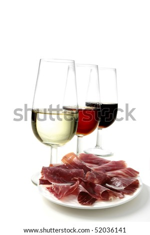 sherry wine and cured ham tapas - stock photo