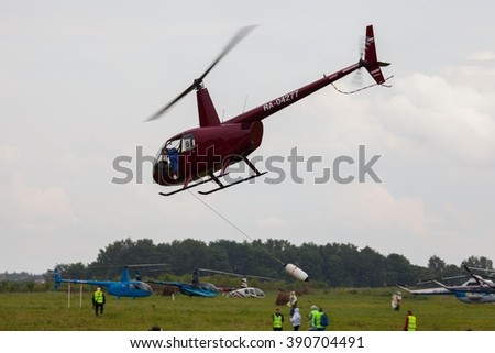 SHEVLINO, MOSCOW REGION, RUSSIA - JUNE 14, 2014: The championship of Russia on helicopter sports. Helicopter Robinson R-44