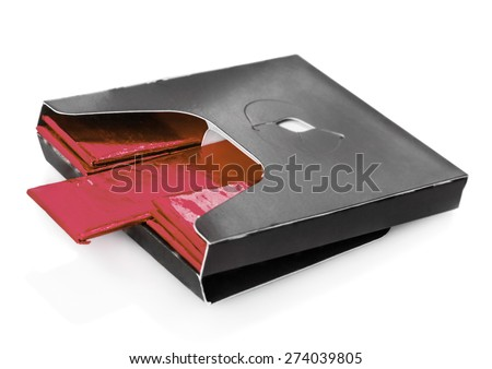 shewing gum deployed in standard red packaging isolated. focus on chewing plate in the center, shallow depth of field - stock photo