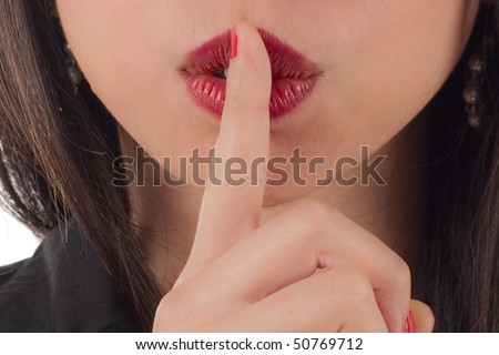 Shhh - Studio shot of beautiful sexy young woman with finger to lips - stock photo