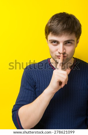 Shhhh - quiet, silence, secret gesture, young handsome man - stock photo