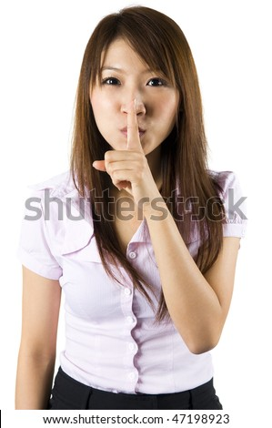 Shhhhh. Asian gesturing on white background. - stock photo