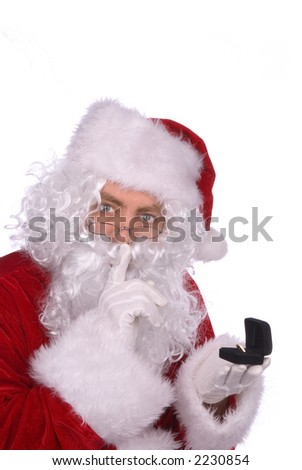 Shhhhhh, Santa Claus is placing a ring under the Christmas tree - stock photo