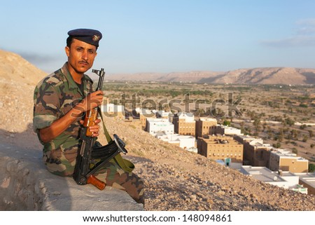 SHIBAM, YEMEN - MAY 10: Yemeni military on duty in the city of Shibam May 10, 2010 in hibam, Yemen. For tourists in Yemen, some provinces may attend only only if accompanied by military guards.