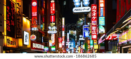 SHIBUYA, TOKYO - MARCH 24: Neon lights in Center gai street on March 24, 2014 in Shibuya, Tokyo. Shibuya is famous for its trend-setting fashion stores and its nightlife.