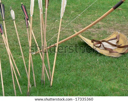 Shield, bow and arrows - stock photo
