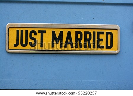 "shield ""just married"" black on yellow with blue background - stock photo"