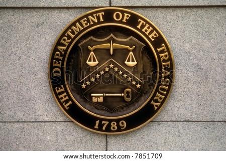 Shield of the US Treasury on Treasury building in Washington, DC - stock photo