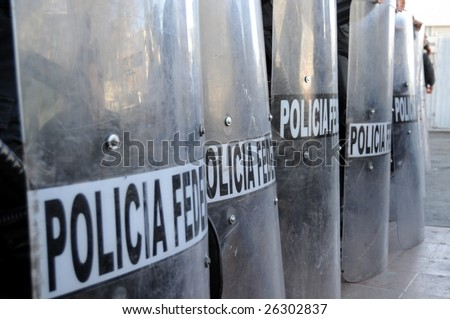 Shields of Mexican federal police forces maintaining order in the violent border city of Ciudad Juarez - stock photo