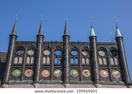 Shields of the city hall in Lubeck, Germany - stock photo
