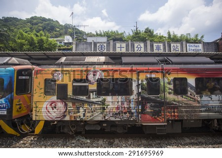Shifen, Taiwan - Jun 7: The beautiful local train is approaching the  Shifen station. it becomes one of the famous tourist stops in Shifen, Taiwan on June 7 2015. - stock photo