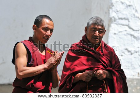 SHIGATSE, TIBET- JUNE 5: Unidentified monks debate in the Tashilunpo monastery area on June 5, 2010 in Shigatse, Tibet. Debating is part of the monastery curriculum to become a higher lama.