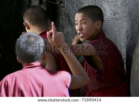SHIGATSE, TIBET- SEPTEMBER 17: Unidentified young monks debate in the Tashilunpo monastery area on September 17, 2010 in Shigatse, Tibet. Debating is part of the monastery curriculum to become a higher lama.