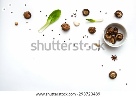 Shiitake mushroom on the White background,Group of india spices arranged in different size terracotta,spices and herbs top view and copy space. - stock photo