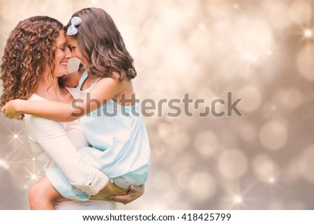 Shimmering light design on grey against happy mother and daughter hugging - stock photo