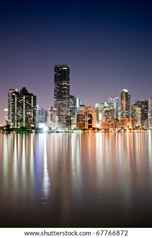shimmering skyline of miami along biscayne bay on cloudless night, december 2010