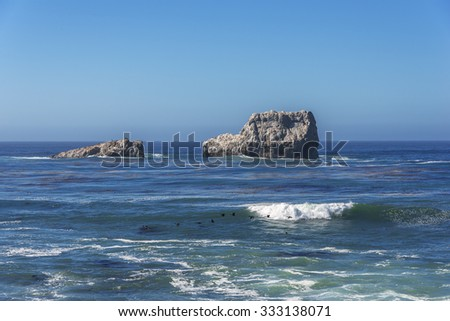 Shimmering sunlight & waves splashing on White Rock at Point Piedras Blancas along the rugged Big Sur coastline, off of the Big Sur Highway (route 1) on the California Central Coast, near Cambria CA. - stock photo