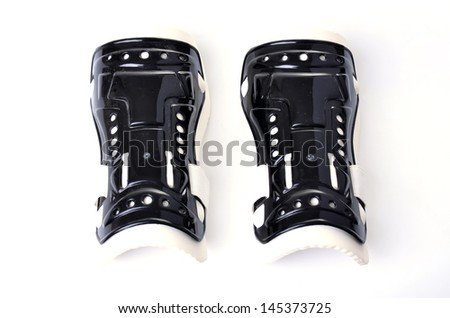 Shin guards is a device used to prevent accidental athlete in competitive soccer. - stock photo