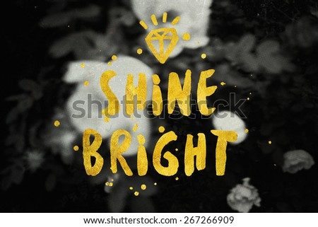 Shine Bright typography poster in black and gold colors. Beauty fashion background. Inspirational quotes. - stock photo
