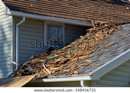 Shingles on House Roof being Torn Off - stock photo