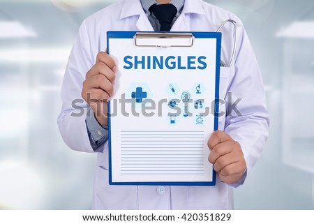 SHINGLES Portrait of a doctor writing a prescription