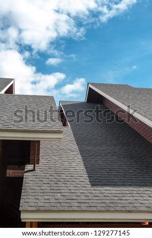shingles roof, contemporary style - stock photo