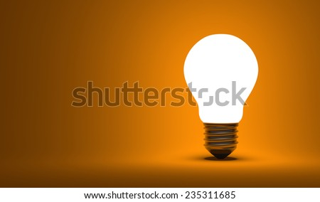 Shining arbitrary light bulb on orange background - stock photo