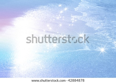 Shining beach with rainbow colored - stock photo
