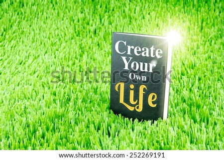 "Shining Black book on grass with "" Create your own life "" word, Business and Education concept - stock photo"