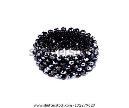 Shining black bracelet. Isolated on a white background. - stock photo