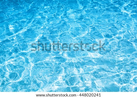 Shining blue water ripple background - stock photo