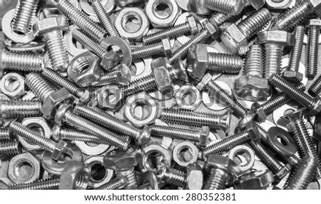 Shining bolts and nuts, photo background with selective focus  - stock photo