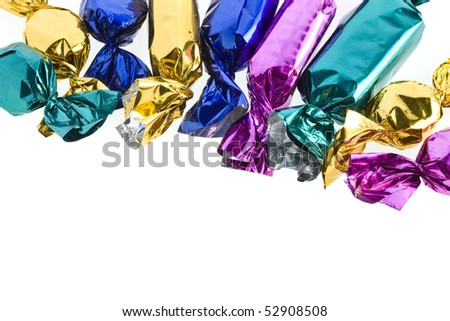 shining candy in color wrapper isolated on white - stock photo