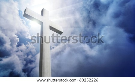 shining cross against dramatic cloudy sky - stock photo