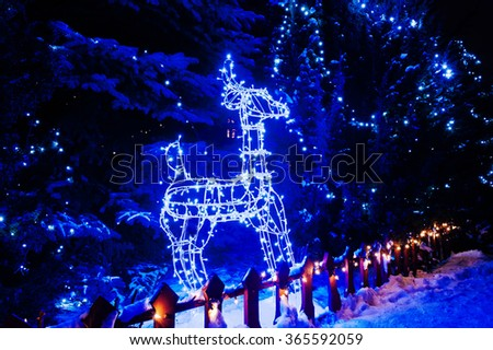 Shining deer of blue lights. Christmas lights - stock photo