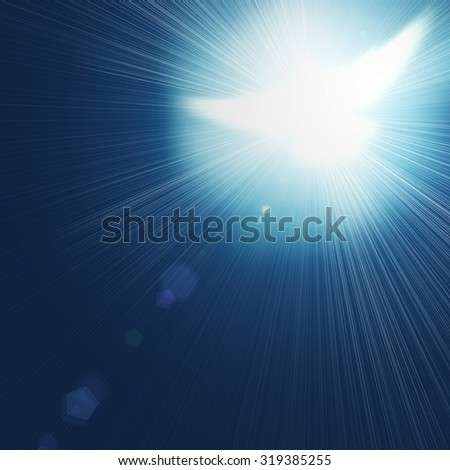 shining dove with rays on a blue background  - stock photo