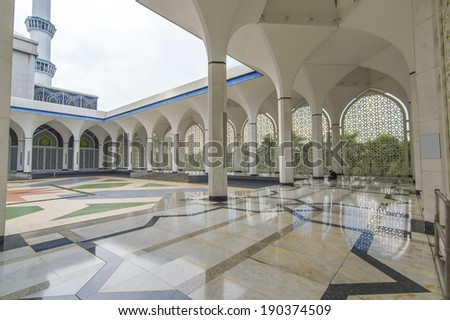 Shining floor marble reflection at mosque corridor - stock photo