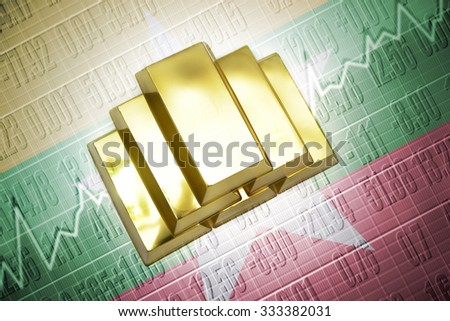 Shining golden bullions lie on a myanmar flag background