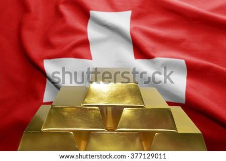 shining golden bullions on the swiss flag background - stock photo