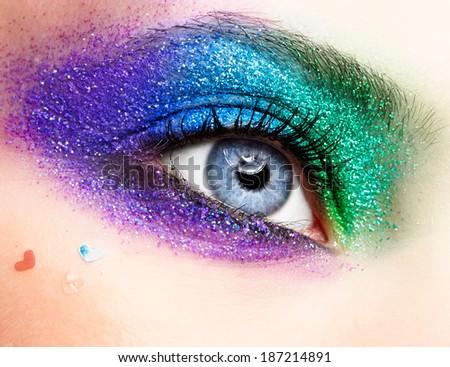 Shining holiday spangled female eye makeup  - stock photo